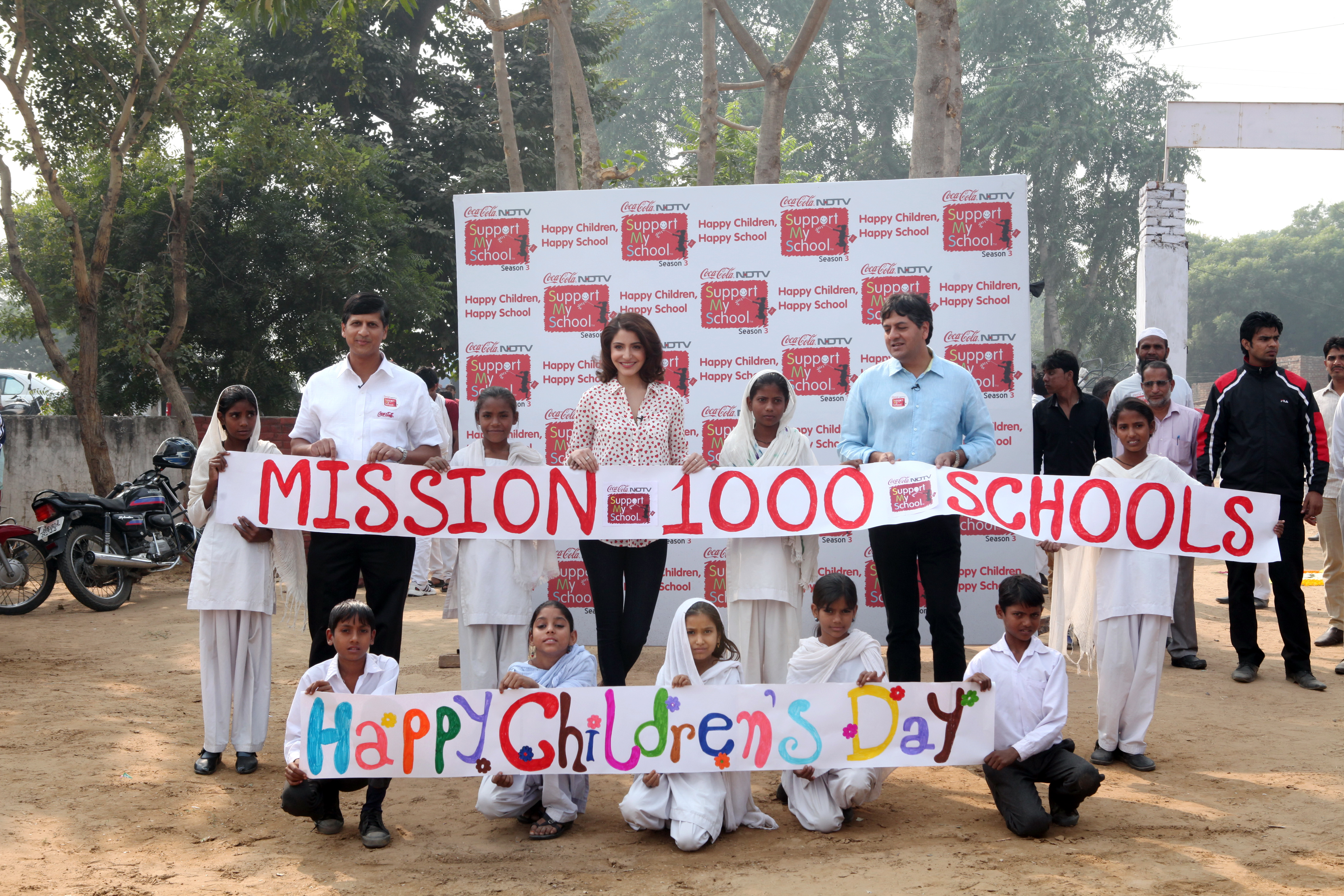 L to R -Venkatesh Kini- President Coca-Cola India and South West Asia,Anushka Sharma &Vikram Chandra –Group CEO-NDTV launched Support My School (SMS) Season 3
