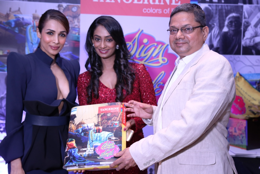 Malaika Arora Khan signs for a CSR initative by Tangerine to donate bedsheets to oldage homes