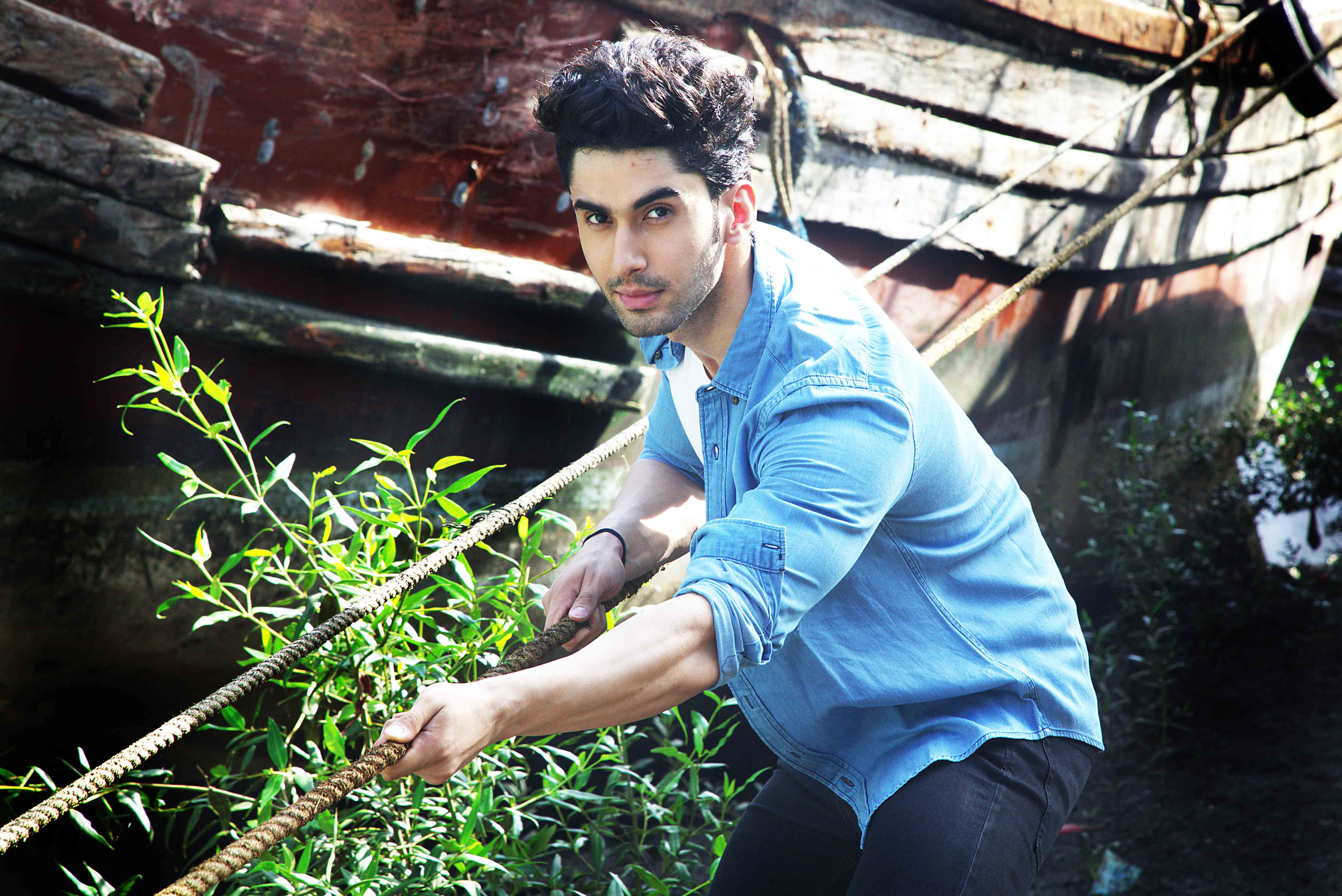 Laksh Lalwani in blue denim shirt